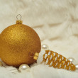 Royalty-Free Stock Photo: Christmas decorations in gold and white colors: cones and balls