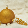 Christmas decorations in gold and white colors — Stock Photo