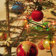 Stockfoto: Christmas tree decorated with toys and sparkling garlands