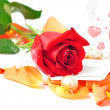 Romantic scenery - red rose on orange petals with hearts and pea — Stock Photo #19952791