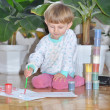 Stock Photo: Happy and cheerful kid with brush paints with space for text