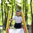 Stock Photo: Calm baby climbs Children slide on playground