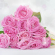 Bouquet of pink roses with glowing luster - greeting card — Stock Photo #31201147