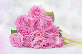 Bouquet of pink roses with glowing luster - greeting card — Stock Photo