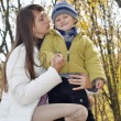 Mom and baby in autumn park for a walk — Stock Photo