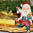 Christmas composition with Santa and golden gift — Stock Photo