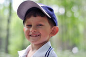Little happy smiling boy in the park — Stock Photo