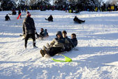 Sled riding in Central Park after snow storm Nemo — Stockfoto