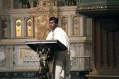 Priest at Saint Jean Baptiste — Stock Photo