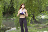 Girl in workout clothes in park — Stock Photo