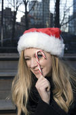 Girl with candy cane — Stock Photo