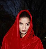 Girl in red robe — Stock Photo