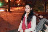 Girl sitting in park — Stock Photo