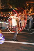 Man hula hoops during Halloween parade — Stock Photo