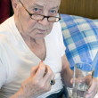 Senior taking meds — Stock Photo #21663851
