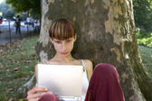 Woman with electronic device — Stock fotografie