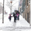 Stock Photo: Mother and child during snow storm in New York