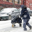 Stock Photo: Mail mduring snow storm in New York