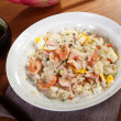 Постер, плакат: Rice with seafood on table