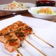 Japanese cuisine skewers — Stock Photo