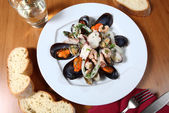 Plate of seafood salad — Stock Photo