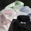 Four men's shirts — Stock Photo #31772173