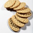 Stock Photo: Group of crackers in semicircle on white