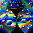 Stock Photo: Water drops on CD wallpaper
