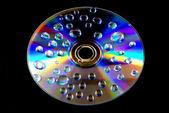 Water drops on CD wallpaper — Stockfoto