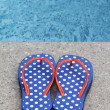 Flip-Flops By The Pool - Stock Photo