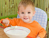 Portrait of little beautiful boy after a meal — Stock Photo