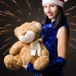 Snow maiden presents toy bear in gift — Stock Photo #16837457