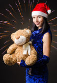 Snow maiden presents a toy bear in a gift — Stock Photo