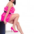 Beautiful sexual girl in pink clothes sits on cubes — Stock Photo #18731719