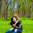 Young mother and son having fun in the woods — Stock Photo #25039955
