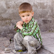 Stock Photo: Cute little boy with hammer in his hand on background of wall