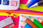 Stationery on a background the coloured paper — Stock Photo
