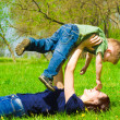 Young mother with son having fun outdoors — Stock Photo