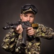 Soldier aiming a machine gun — Stock Photo