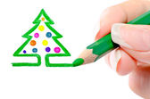 Photo picturing hands pencil a Christmas tree — Stock Photo