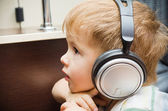 Portrait of a beautiful little boy in headphones — Stockfoto