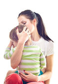 Mother calms a crying child — Stock Photo