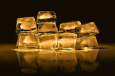 Ice cubes of  gold color — Stock Photo