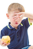 Portrait of a boy covering face with  hand — Stock Photo