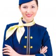 Beautiful smiling stewardess — Stock Photo