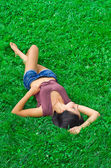 Beautiful young sexy woman lying on the meadow — Stock Photo