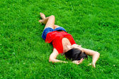 Beautiful young sexy woman lying on the grass — Stock Photo