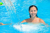 Portrait of a beautiful young woman in the pool — Stock Photo