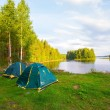 Karelia, tents on bank of lake — Stock Photo #41203895