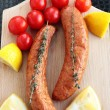 Sausages with cherry tomatoes, lemon and thyme — Stock Photo